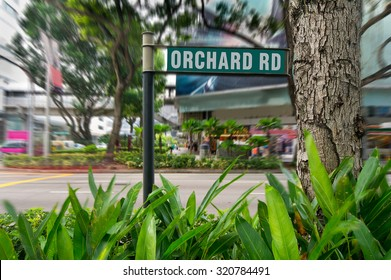 A Street View Of The Orchard Road In Singapore With The Motion Blur. The Orchard Road Longs 2.2 Kilometers And One Of The Major Tourist Attractions And The Entertainment Hub Of Singapore