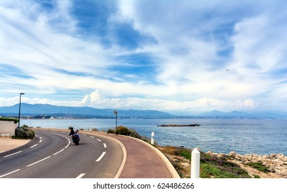 street view over Antibes bay with unidentified biker from Cap d'Antibes.