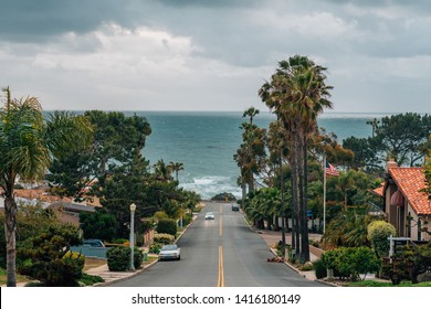 A street with view of the Pacific Ocean on a cloudy day, in Point Loma, San Diego, California