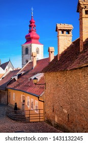 Street view with Ptuj City Tower in the center of old town in Slovenia. Building architecture in Slovenija. Travel