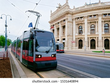 Street view public tram at Burgtheater in Hofburg Complex, Old city center in Vienna, Austria. Innere Stadt in Wien in Europe. Cityscape. Theater building landmark. Theatre architecture. Mixed media - Shutterstock ID 1531640894