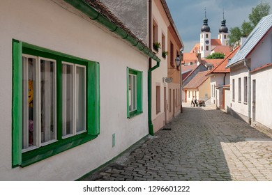 Street view with the St. James church in the background at the city of Telc, Vysocina Region, CZ