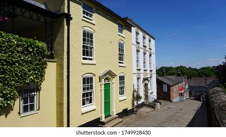 Street view with three storey buildings in Knutsford Cheshire England on a sunny day June 2020