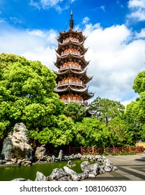 Street view at traditional Chinese pagoda. Chinese old town in the center of Shanghai city. Day view at the street of the Chinese city. People on the streets of Shanghai. Ancient buildings in old town