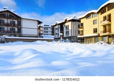 Street view, traditional houses and high snow in bulgarian ski resort Bansko, Bulgaria