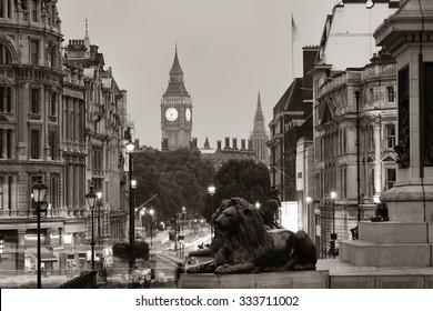 Street view of Trafalgar Square at night in London in BW