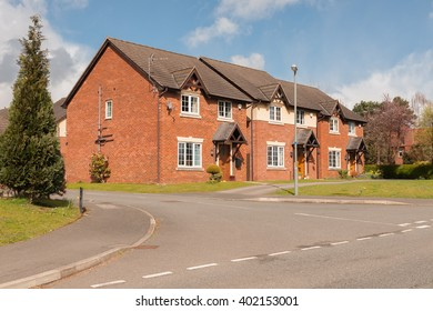 Street view of a typical mix of mid price range detached modern residential housing development in the United Kingdom