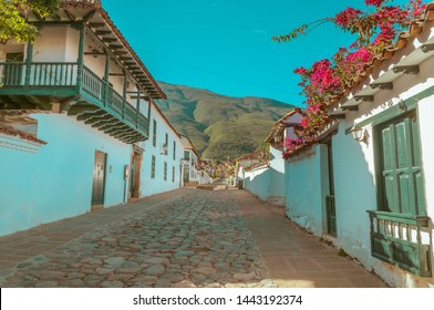 Street of Villa de Leyva with mountain in the background