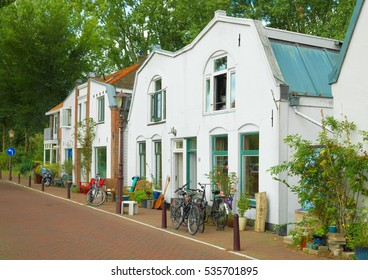 Street with vintage traditional houses in Schellingwoude suburb of Amsterdam, the Netherlands