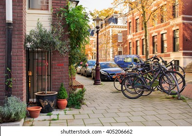 Street Vondelstraat in the center of Amsterdam. Netherlands. / Picturesque quiet residential street near the city park Vondelpark. Amsterdam, The Netherlands.