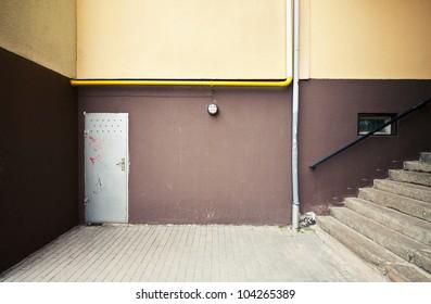 Street wall, floor, stairs. Urban background.
