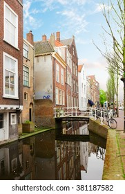 street and water  canal in old town of Delft in spring time, Holland