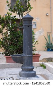 Street well for potable water on street of small town in Southern Italy