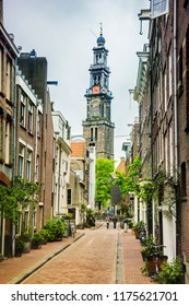 Street and Westerkerk Church tower in Amsterdam, Netherlands.