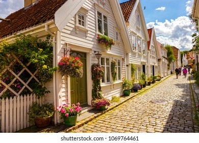 Street with white houses in the old part of Stavanger, Norway.