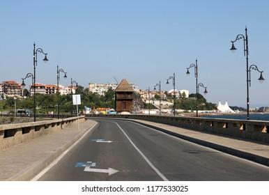 Street and windmill Nessebar Bulgaria