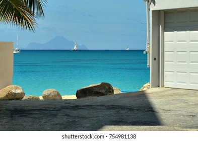 Street without exit. In the background the beautiful beach of Simpson Bay with its turquoise blue sea.