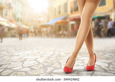 street woman legs red heels sun light of summer time and free space