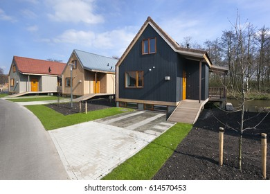 Street with wooden vacation houses in Reeuwijk in the Netherlands