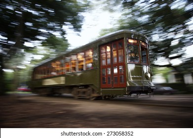 Streetcar cable car running through the leafy Garden District of New Orleans
