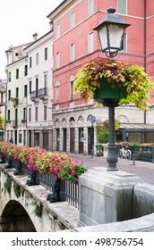 Streetlamp in the flowered Saint Paul bridge, Vicenza, Italy