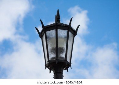 Streetlight against a cloudy sky background