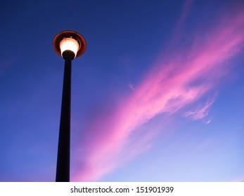 streetlight under red cloudy