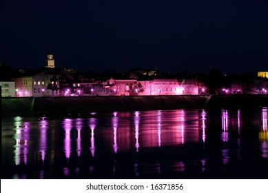Streetlights reflecting in river Rhone at Arles, southern France
