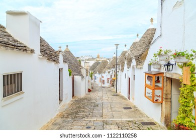 Streets of Alberobello town with Trulli houses in Apulia, Italy