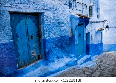 Streets of blue city, Chefchaouen in Marocco. White and blue buildings and narrow streets in medina of famous blue city.