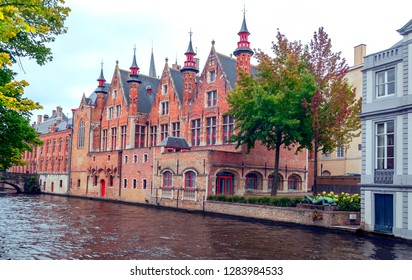 Streets of Bruges in Belgium with its medieval style facades on a cloudy day.