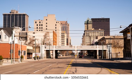 The streets and buildings of Dayton Ohio only have a few travelers early Sunday morning