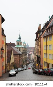 Streets and buildings in Neurenburg - Munich.  Movement on cars driving.