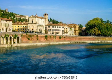 Streets and buildings of Verona city at the sunny summer day.  Because of the value of its historical buildings, Verona has been named a UNESCO World Heritage Site