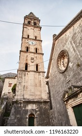 The streets of the city of Perast. The clock tower in the town of Perast. Montenegro.