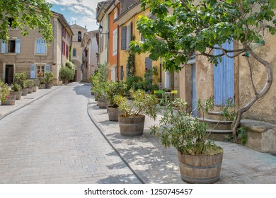 In the streets of Cucuron. Narrow street leading up to the church in Cucuron, Provence, Luberon, Vaucluse,  France