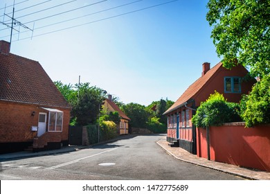 Streets of Denmark with colorful buildings on the island of Bornholm in the summer