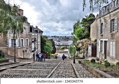 Streets of historic center in city of Angers. France. City is home for Chateau d'Angers and listed as historical monument- popular tourist stop in Loire Valley. Photo 2014-04-27