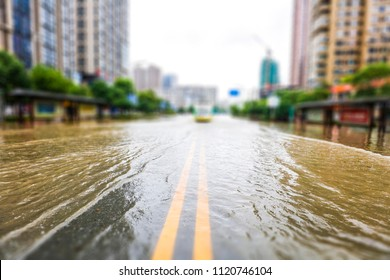 Streets inundated by heavy rain in the city. The background of urban construction and management.