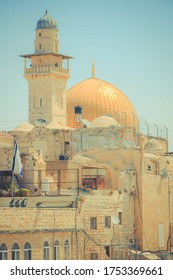 Streets of Jerusalem. Dome of the Rock and Bell Tower of the Lutheran Church of the Savior .