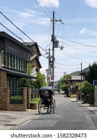 The streets of Kyoto with classic buildings and a rickshaw ride