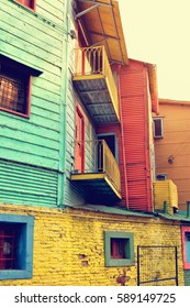 Streets of La Boca in Buenos Aires, Argentina with number of colorful houses and tango teachers.