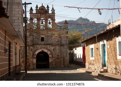 Streets of a magical town in one of the states of Mexico with a chapel in the background