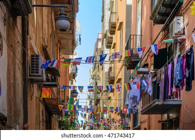 Streets of Naples, June 11, 2016 in Naples, Italy. Many international small flags hanging from ropes along streets.