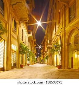 Streets at night in Milano, Italy
