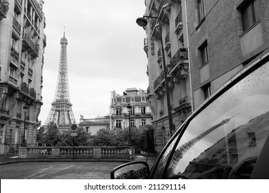 Streets of Paris with Eiffel Tower in background in black and white