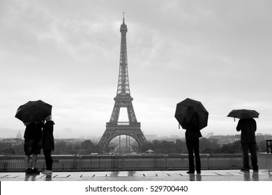 Streets of Paris with Eiffel Tower in rain