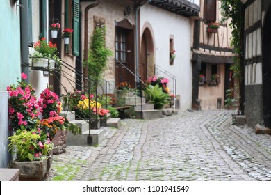The streets of the villages in Alsace are cluttered with pots of multicolored flowers.