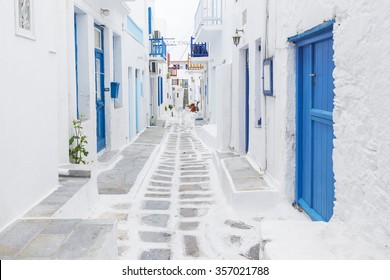 Streetview of Mykonos with whitewashed walls and blue doors and windows, Greece
