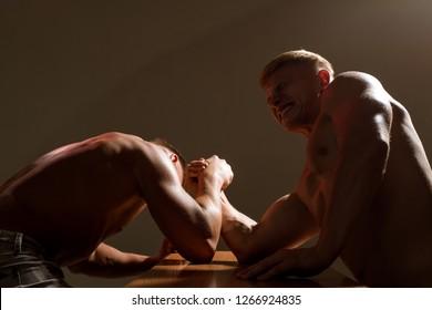 Strength on his side. Twins men competing till victory. Men competitors try to win victory or revenge. Twins competitors arm wrestling. Revenge in sport. Strength skills.
